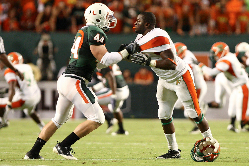 10 October 2009:  Miami (FL) linebacker Colin McCarthy (44) gets into a pushing match with Florida A&M wide receiver Kevin Elliott (5).  The No 11. Miami Hurricanes defeated Florida A & M Rattlers 48-16 at Landshark Stadium in Miami Gardens, FL.